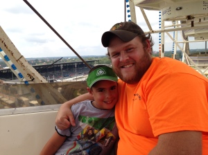 Charlie and the Old Man on the ferris wheel. From the top you can see the Des Moines skyline and the Iowa state capitol building to the west. To the east, hundreds of miles of pure Iowa farmland. At the Iowa State Fair in Des Monies.