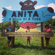 Being greeted by a bear holding up a whale. Anita, IA in Cass County.