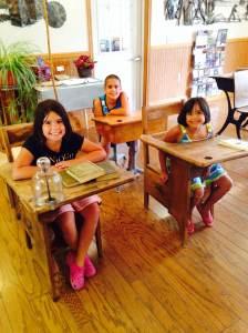 Taking a break at the antique school desks. Jackson County Welcome Center near Sabula, IA.