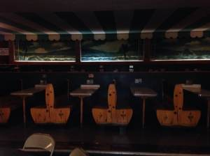 The booths surround the Surf's dance floor. Like the Barrel Drive-In, Many of them still have the intercom ordering system attached to the tables. At the Surf Ballroom in Clear lake, IA.