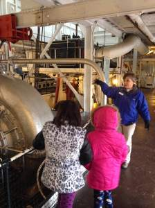 Dee showing the kids the intricate engine room that powered this the William M. Black. The crew was commissioned to stay on the dredger for 6 strait months only touching land after their contract was complete.