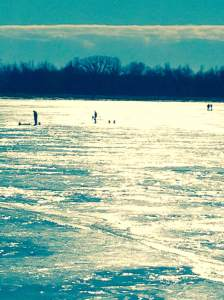 Ice fishing on an amazingly sunny and mild January day. At Terry Trueblood Recreation Area in Iowa City, IA.