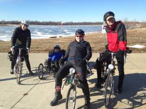 Get out and get to cycling! These wintertime road warriors are Caitie, Noelle, Bobby and Toby of Hills, IA.