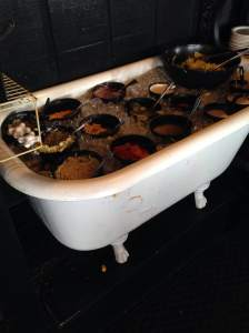 An antique tub full of ice and turned into a very unique salad bar. For all you freaks that say you could bathe in ranch dressing, Sneaky Pete's may have you covered. For the right price that is.  https://www.facebook.com/pages/Sneaky-Petes-Woodfire-Grille/159040317451681
