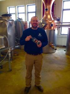 Garrett showing off the distillery at the Mississippi River Distilling Company.