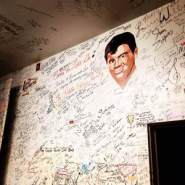 """A portrait of Ritchie Valens looks over the """"green room"""" of the Surf Ballroom. The signatures of performers covers the walls and ceiling. It's one of music's best collections of signatures you'll find anywhere in the world. The small room is a tour in itself. At the Surf Ballroom in Clear Lake, IA."""