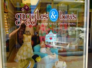 The eye catching storefront of Giggles & Bows in downtown Grinnell. From children's sundresses to outfits that junior can wear to all occasions. JoAnn has it all ready to throw on! https://www.facebook.com/GigglesNBowsGrinnell