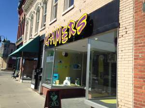 The modern storefront nestled in to the historic Grinnell downtown district. They've got Gamers!
