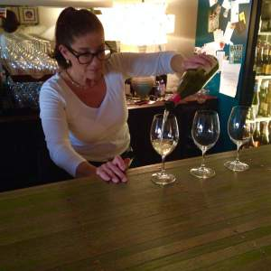 Colleen Kleinart pours the goods at Solera in Grinnell, IA.