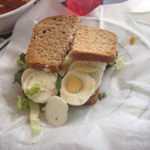 Monie ordered the egg salad sandwich. fresh Deli has their own take on this classic sandwich, made with their fresh baked bread by the way. Instead of a giant scoop of mayonnaise with a few chopped eggs, Fresh Deli slices their local boiled eggs and serves it on local greens. Hence