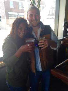 Meet Joe and Kirsten! They're holding up a Farmer Brown Ale ans a West Coast IPA. Enjoying the afternoon at Great River Brewery in Davenport, IA.