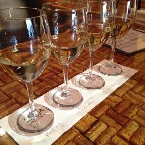 Pouring a white wine flight for their excited customers! They started with a Ravenna Riesling, then a Kim Crawford Sauvignon Blanc, Fly Girl White Blend and a Maddalena Chardonnay. Getting thirsty yet?