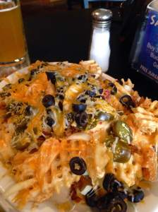 Boom!! Idaho Nachos! Waffle fries with a cheesy, spicy and meaty sensation that you can only experience at Sneakers in Fort Dodge.