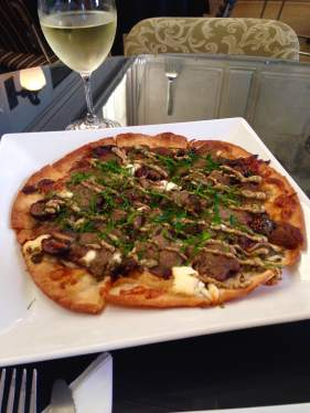 Meet your new best friend, amigos. The potato dough is used for the crispy crust and is topped with duck confit, mozzarella, goat cheese, fresh basil, stone ground mustard and balsamic onion. Ladora Bank Bistro in Ladora. https://twitter.com/LadoraBistro