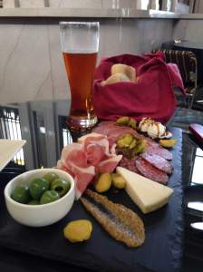 The bistro's charcuterie board! Artisan cheeses, thinly sliced meats, bread and olives. Also on the board was an amazing surprise. Their own pickled brussel  sprouts. The news on these were spreading up and down route 6 and they were down to there last jar! https://www.facebook.com/ladorabankbistro?fref=ts