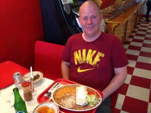 Bellying up to a La Juanita Carnitas Burritos is Ray Wetherell. The driving force behind The Forgotten Iowa Historical Society. Ray is tirelessly updating the world on some of the most interesting locals our home state has to offer. Not only does he keep up on this amazing service to Iowa's history, he keeps up his service to our country in the National Guard. Please check out Forgotten Iowa Historical Society Facebook page. It's one of the best ways to plan a spontaneous trip through the cornbelt! https://www.facebook.com/groups/forgotteniowa/