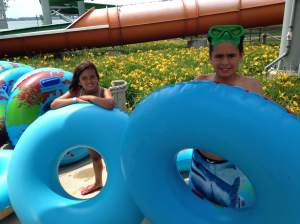 Charlie and Gigi ready to raft down the pipes of Kings Pointe Waterpark in Storm Lake, IA. https://twitter.com/kings_pointe