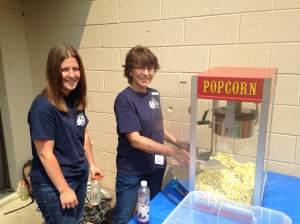 In the nearby park are community volunteers, Stacey and Judy. Serving up free popcorn, juice and bottled water.