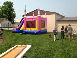 The inflatable bouncy house showed up and for the record breaking 10,000th time a row I was told I was too big to join in. What-evs...