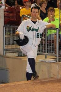 All but willing more runs on the scoreboard. Jon takes a breather during a pitching change late in the game. His concerned gaze would soon change. (Picture from the CR-Kernels Facebook page)