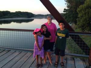 A quiet river, a historic bridge and one damn happy family! At the Sutliff Bridge in Sutliff, IA. https://www.facebook.com/Sutliff-Bridge-Authority-221625791188334/timeline/