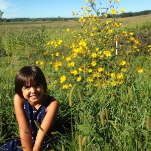 Late September in rural Iowa. Gigi finding her wild (flower) side. Near Sharon Center, IA.