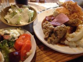 Pickled vegetables, fresh garden salad and a plate piled high with Iowa comfort food. Gravy on everything!