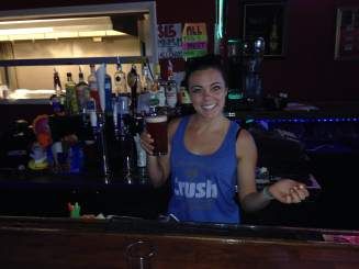 Serving up some icy cold Fruli Strawberry beer is the Quarthouse bartenderess, Jessica. She's got the skills to keep with any and all RAGBRAI teams!